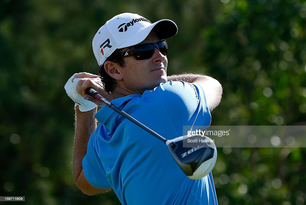 <a gi-track='captionPersonalityLinkClicked' href=/galleries/search?phrase=Justin+Rose&family=editorial&specificpeople=171559 ng-click='$event.stopPropagation()'>Justin Rose</a> of England hits his tee shot on the eighth hole during the third round of the Abu Dhabi HSBC Golf Championship at Abu Dhabi Golf Club on January 19, 2013 in Abu Dhabi, United Arab Emirates.