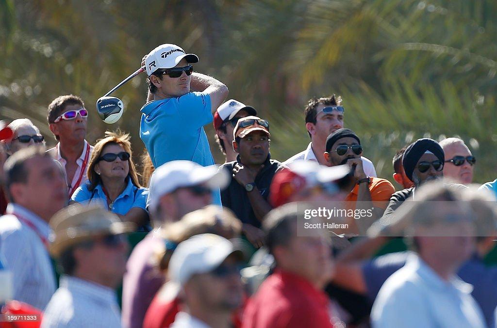 Justin Rose of England hits his tee shot on the ninth hole during the third round of the Abu Dhabi HSBC Golf Championship at Abu Dhabi Golf Club on January 19, 2013 in Abu Dhabi, United Arab Emirates.