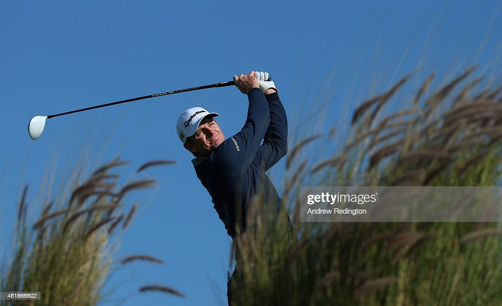 Justin Rose of England hits his teeshot on the 16th hole during the first round of the Commercial Bank Qatar Masters at Doha Golf Club on January 21...