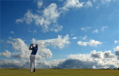 Justin Rose of England hits hit approach shot on the 16th hole during the final round of the 2014 Aberdeen Asset Management Scottish Open at Royal...