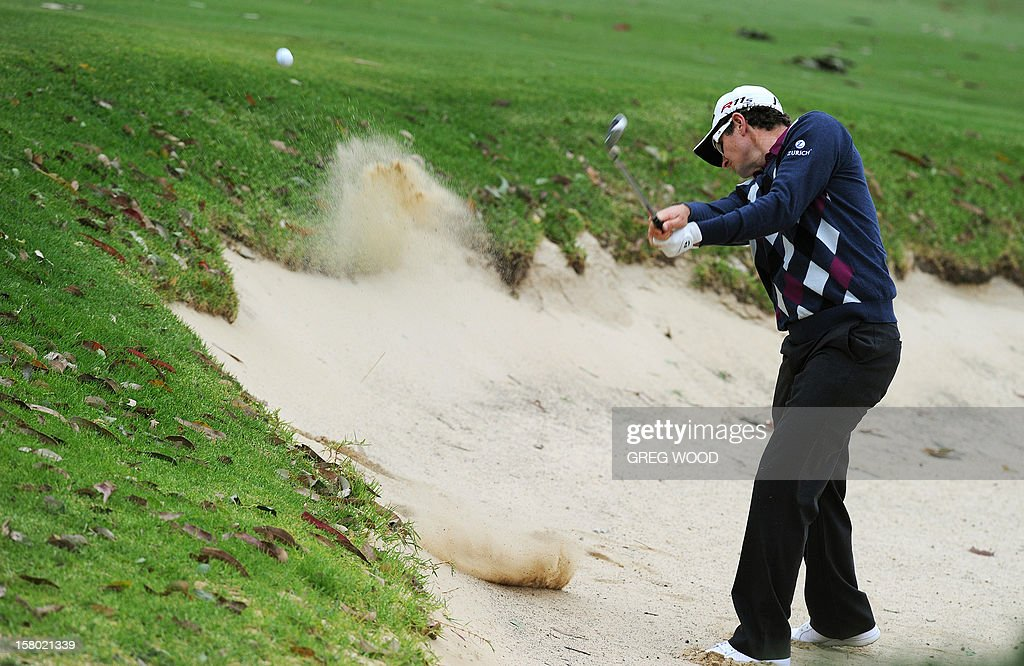 Justin Rose of England hits out of a bunker during the final round of the Australian Open golf at The Lakes course in Sydney on December 9, 2012. IMAGE STRICTLY RESTRICTED TO EDITORIAL USE - STRICTLY NO COMMERCIAL USE AFP PHOTO / Greg WOOD