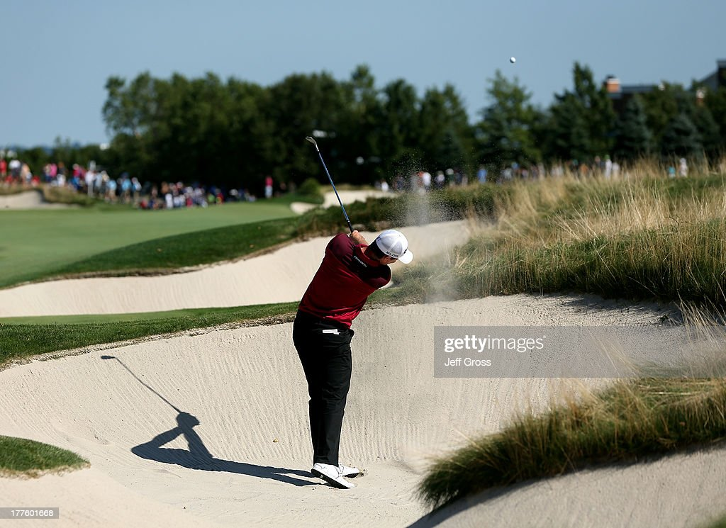 Justin Rose of England hits out of a bunker on the 13th hole during the third round of The Barclays at Liberty National Golf Club on August 24 2013...