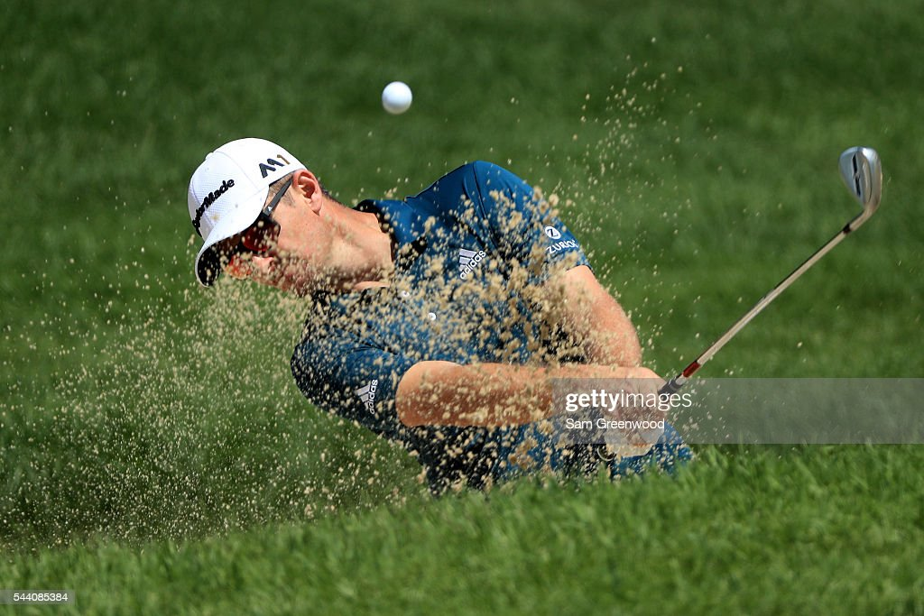 Justin Rose of England hits out of a bunker on the first hole during the second round of the World Golf Championships - Bridgestone Invitational at Firestone Country Club South Course on July 1, 2016 in Akron, Ohio.