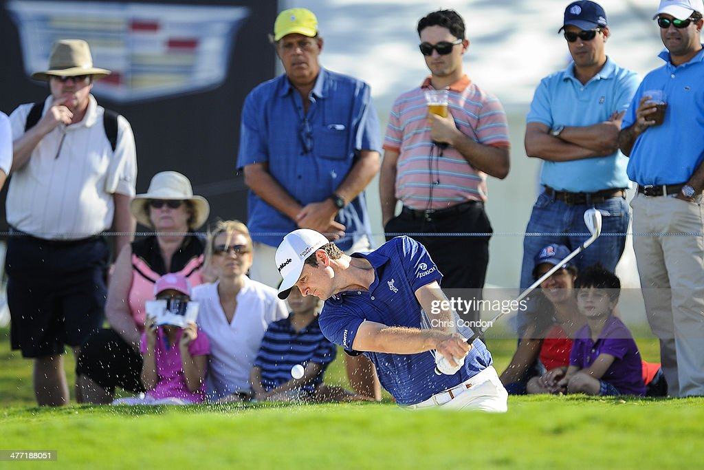 Justin Rose of England hits out of a bunker onto the seventh green during the second round of the World Golf Championships-Cadillac Championship at Blue Monster, Trump National Doral, on March 7, 2014 in Doral, Florida.