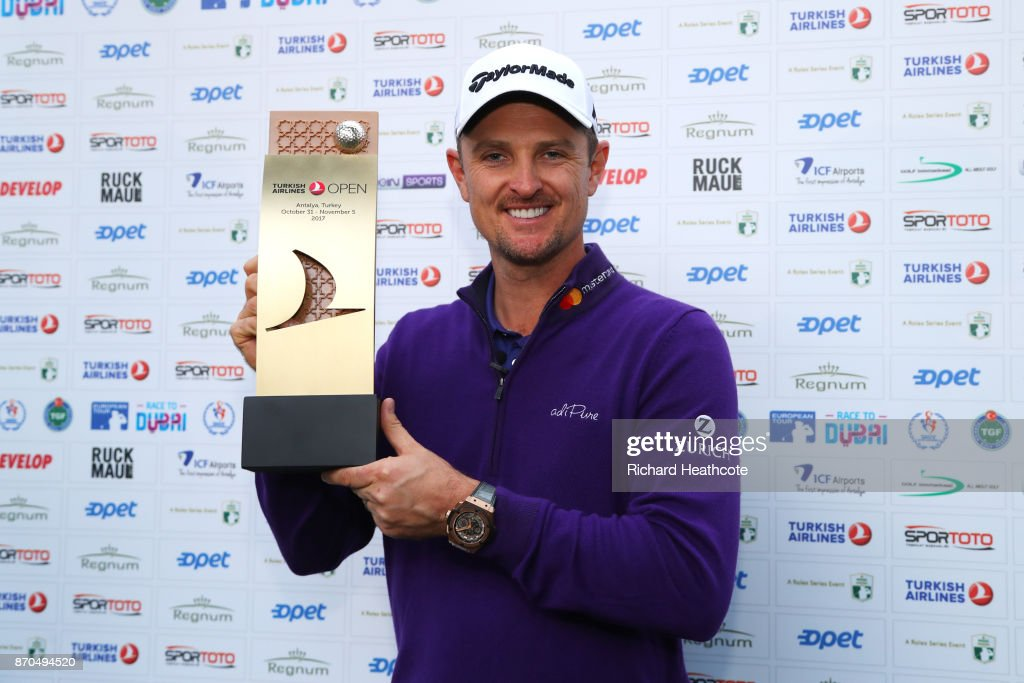 Justin Rose of England holds the trophy after his victory during the final round of the Turkish Airlines Open at the Regnum Carya Golf & Spa Resort on November 5, 2017 in Antalya, Turkey.