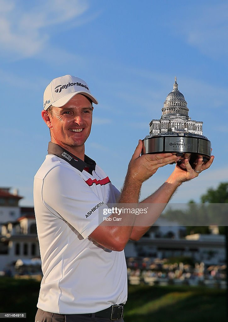 <a gi-track='captionPersonalityLinkClicked' href=/galleries/search?phrase=Justin+Rose&family=editorial&specificpeople=171559 ng-click='$event.stopPropagation()'>Justin Rose</a> of England holds the trophy after winning the Quicken Loans National at Congressional Country Club on June 29, 2014 in Bethesda, Maryland.