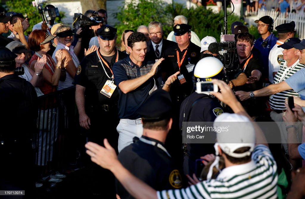 Justin Rose of England is congratulated as he walks to the trophy presentation after winning the 113th US Open at Merion Golf Club on June 16 2013 in...