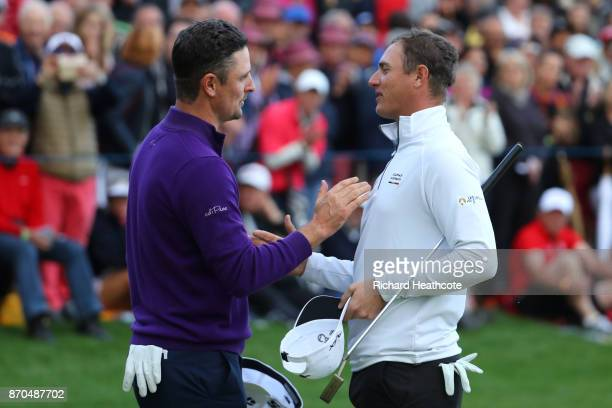 Justin Rose of England is congratulated by Nicolas Colsaerts of Belgium on the 18th green during the final round of the Turkish Airlines Open at the...