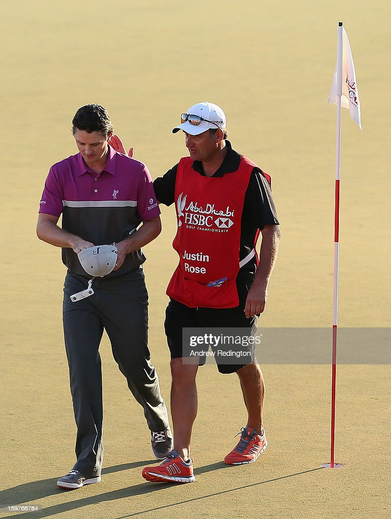 Justin Rose of England is consoled by his caddie on the 18th green during the final round of The Abu Dhabi HSBC Golf Championship at Abu Dhabi Golf Club on January 20, 2013 in Abu Dhabi, United Arab Emirates.