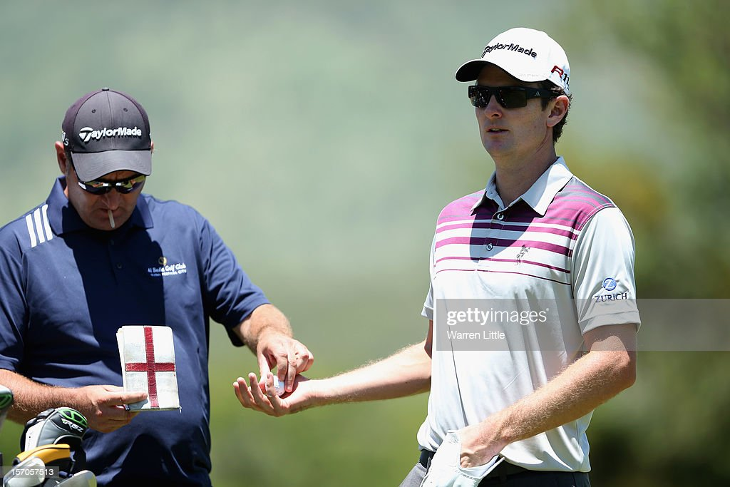 Justin Rose of England is passed a ball by his caddie during the Pro-Am of the Nedbank Golf Challenge at the Gary Player Country Club on November 28, 2012 in Sun City, South Africa.