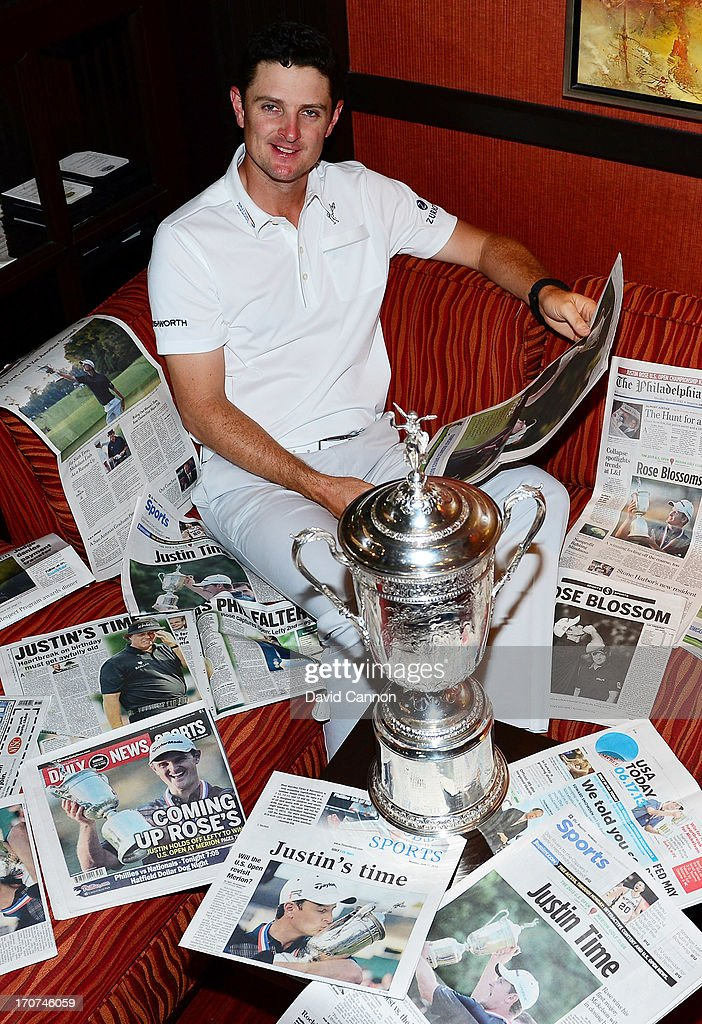 <a gi-track='captionPersonalityLinkClicked' href=/galleries/search?phrase=Justin+Rose&family=editorial&specificpeople=171559 ng-click='$event.stopPropagation()'>Justin Rose</a> of England is surrounded by the morning papers as he reads the stories of his US Open win at Merion Golf Club at his hotel on June 17, 2013 in Conshohocken, Pennsylvania.