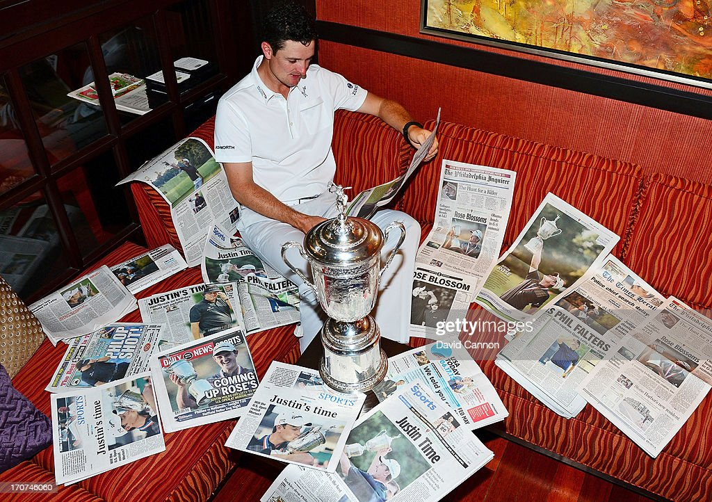 Justin Rose of England is surrounded by the morning papers as he reads the stories of his US Open win at Merion Golf Club at his hotel on June 17, 2013 in Conshohocken, Pennsylvania.