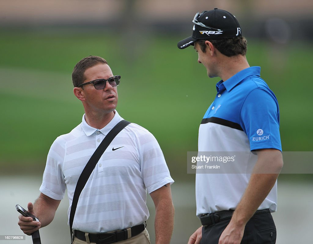 Justin Rose of England is watched by coach Sean Foley during the pro am of the Honda Classic at PGA National on February, 2013 in Palm Beach Gardens, Florida