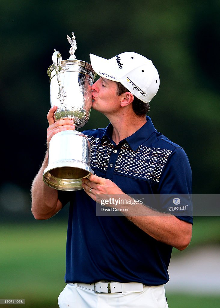 Justin Rose of England kisses the US Open trophy after winning the 113th US Open at Merion Golf Club on June 16 2013 in Ardmore Pennsylvania