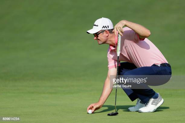 Justin Rose of England lines up a putt on the 15th green during round three of The Northern Trust at Glen Oaks Club on August 26 2017 in Westbury New...