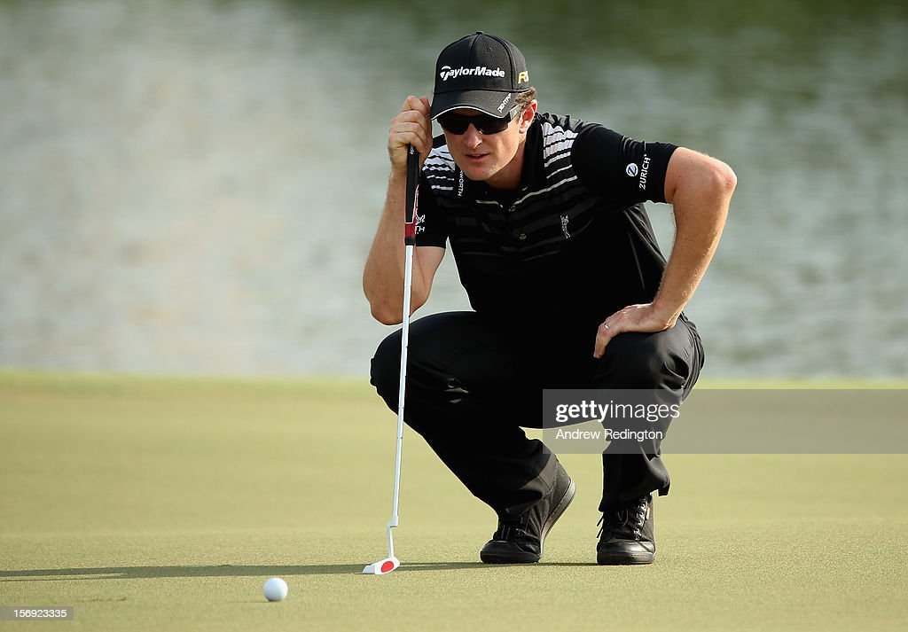 Justin Rose of England lines up a putt on the 17th hole during the final round of the DP World Tour Championship on the Earth Course at Jumeirah Golf Estates on November 25, 2012 in Dubai, United Arab Emirates.
