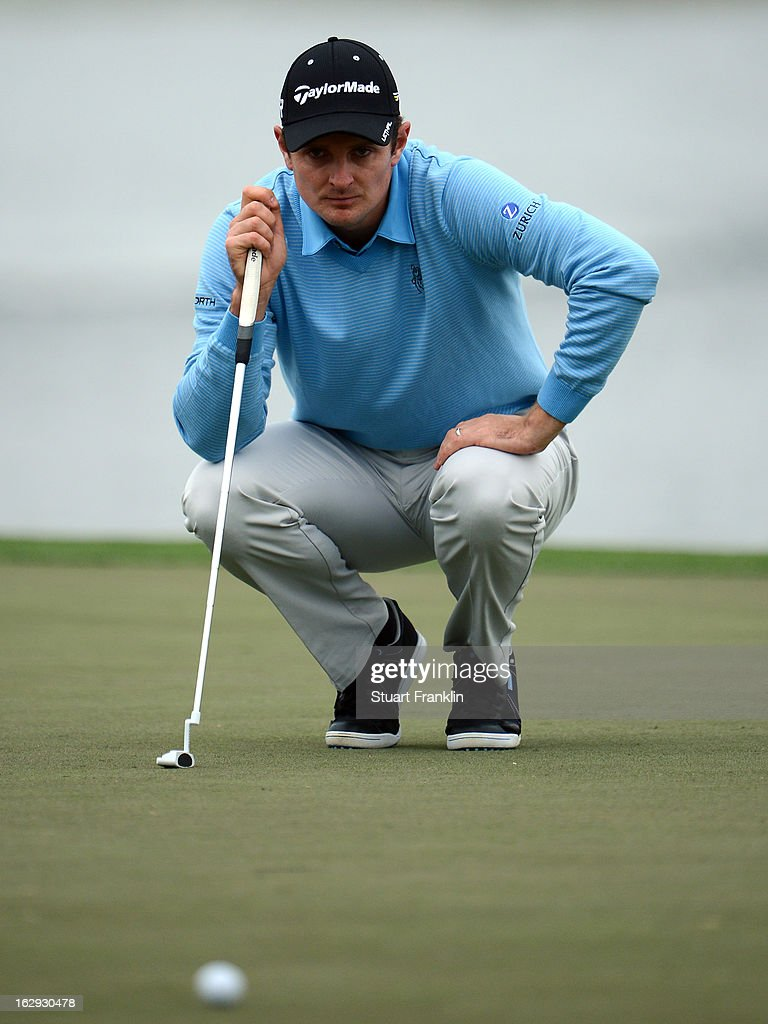 Justin Rose of England lines up a putt on the 18th hole during the second round of the Honda Classic on March 1, 2013 in Palm Beach Gardens, Florida.