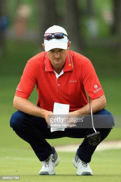 Justin Rose of England lines up a putt on the fifth green during round two of The Northern Trust at Glen Oaks Club on August 25 2017 in Westbury New...