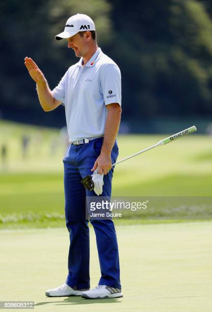 Justin Rose of England lines up a putt on the ninth green during round one of The Northern Trust at Glen Oaks Club on August 24 2017 in Westbury New...