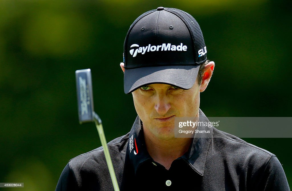 Justin Rose of England lines up a putt on the ninth green during the second round of the World Golf Championships-Bridgestone Invitational at Firestone Country Club South Course on August 1, 2014 in Akron, Ohio.