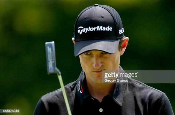 Justin Rose of England lines up a putt on the ninth green during the second round of the World Golf ChampionshipsBridgestone Invitational at...