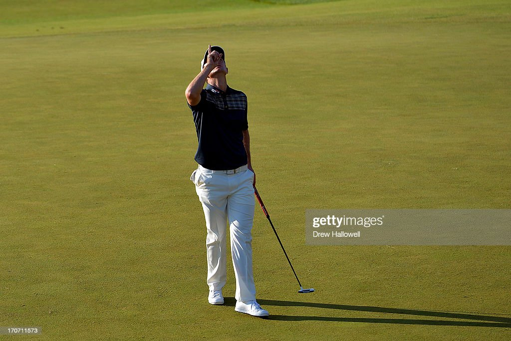 Justin Rose of England looks to the heavens in acknowledgement of his deceased father after putting on the 18th hole to complete the final round of the 113th U.S. Open at Merion Golf Club on June 16, 2013 in Ardmore, Pennsylvania.