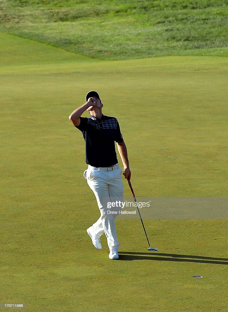 Justin Rose of England looks to the heavens in acknowledgement of his deceased father after putting on the 18th hole to complete the final round of...