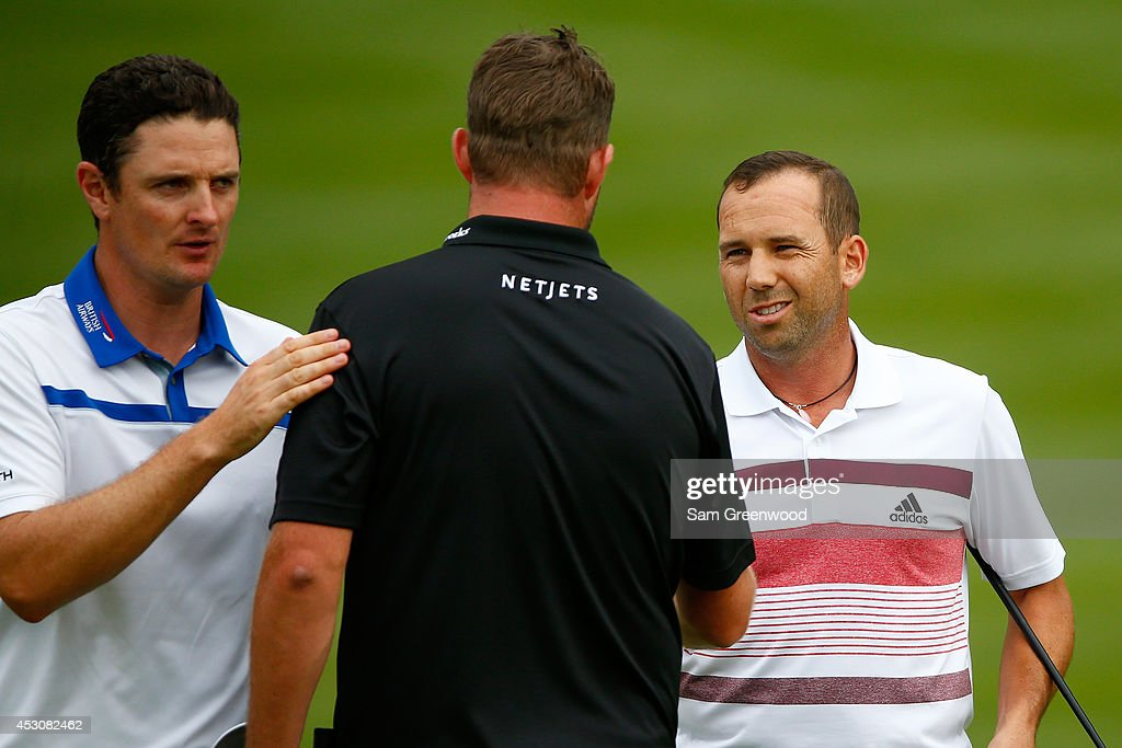 <a gi-track='captionPersonalityLinkClicked' href=/galleries/search?phrase=Justin+Rose&family=editorial&specificpeople=171559 ng-click='$event.stopPropagation()'>Justin Rose</a> of England, <a gi-track='captionPersonalityLinkClicked' href=/galleries/search?phrase=Marc+Leishman&family=editorial&specificpeople=2582046 ng-click='$event.stopPropagation()'>Marc Leishman</a> of Australia and Sergio Garcia of Spain shake hands on the 18th green during the third round of the World Golf Championships-Bridgestone Invitational at Firestone Country Club South Course on August 2, 2014 in Akron, Ohio.
