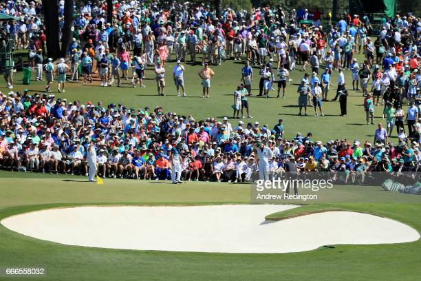 Justin Rose of England misses a putt on the second hole during the final round of the 2017 Masters Tournament at Augusta National Golf Club on April...