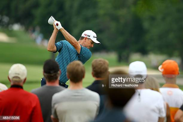 Justin Rose of England of England hits off the ninth tee during the third round of the World Golf Championships Bridgestone Invitational at Firestone...