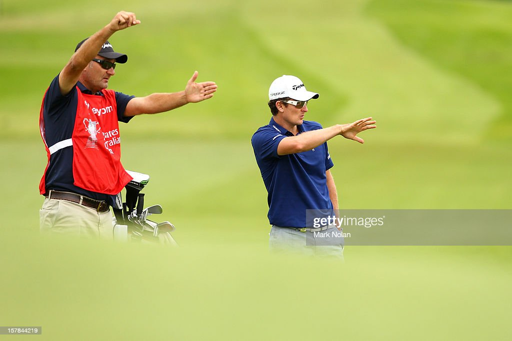 <a gi-track='captionPersonalityLinkClicked' href=/galleries/search?phrase=Justin+Rose&family=editorial&specificpeople=171559 ng-click='$event.stopPropagation()'>Justin Rose</a> of England plans his shot during round two of the 2012 Australian Open at The Lakes Golf Club on December 7, 2012 in Sydney, Australia.
