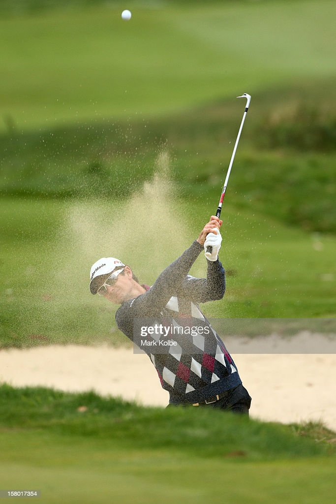 Justin Rose of England plays a bunker shot during round four of the 2012 Australian Open at The Lakes Golf Club on December 9, 2012 in Sydney, Australia.