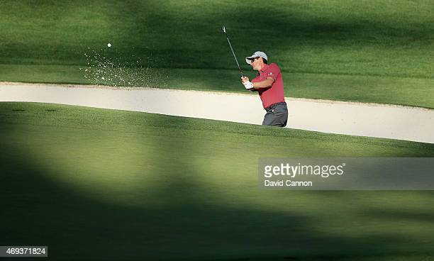 Justin Rose of England plays a bunker shot on the 16th hole during the third round of the 2015 Masters Tournament at Augusta National Golf Club on...