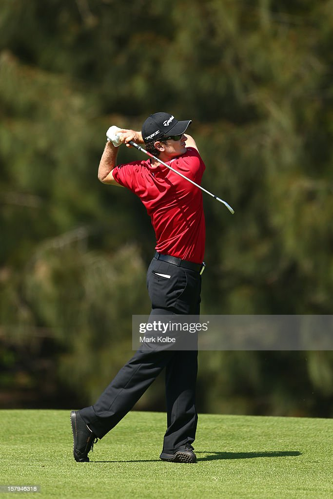 Justin Rose of England plays a fairway shot during round three of the 2012 Australian Open at The Lakes Golf Club on December 8, 2012 in Sydney, Australia.