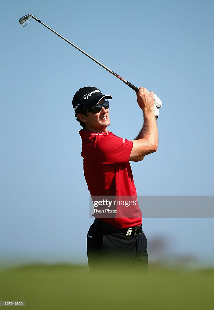 <a gi-track='captionPersonalityLinkClicked' href=/galleries/search?phrase=Justin+Rose&family=editorial&specificpeople=171559 ng-click='$event.stopPropagation()'>Justin Rose</a> of England plays a fairway shot during round three of the 2012 Australian Open at The Lakes Golf Club on December 8, 2012 in Sydney, Australia.
