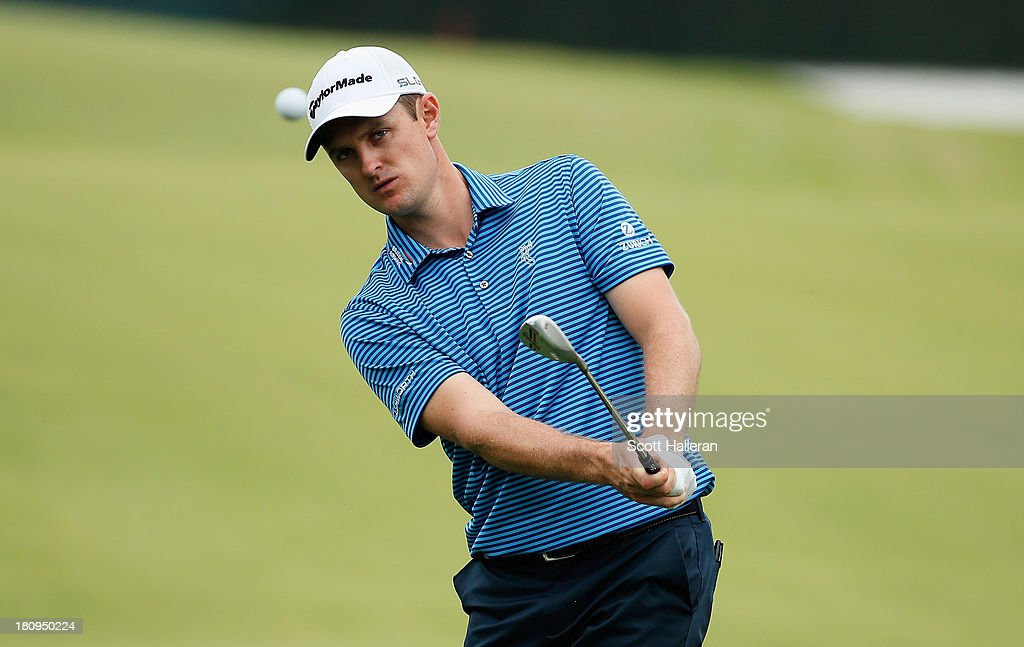 Justin Rose of England plays a shot during a practice round prior to the start of the TOUR Championship by Coca-Cola at East Lake Golf Club on September 18, 2013 in Atlanta, Georgia.
