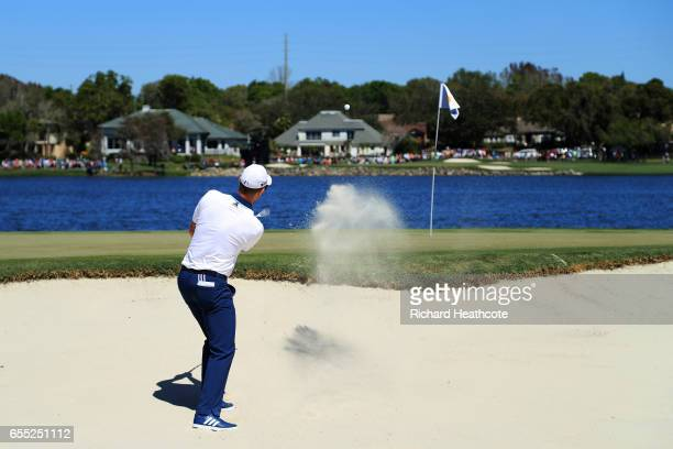 Justin Rose of England plays a shot from a bunker on the sixth hole during the final round of the Arnold Palmer Invitational Presented By MasterCard...