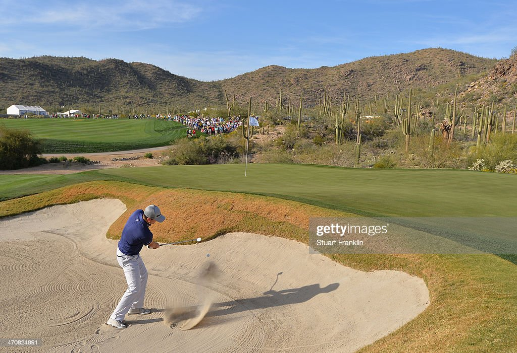 Justin Rose of England plays a shot on the 18th hole during the second round of the World Golf Championships - Accenture Match Play Championship at The Golf Club at Dove Mountain on February 20, 2014 in Marana, Arizona.