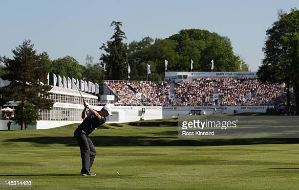 Justin Rose of England plays a shot on the 18th hole during the third round of the BMW PGA Championship on the West Course at Wentworth on May 26...