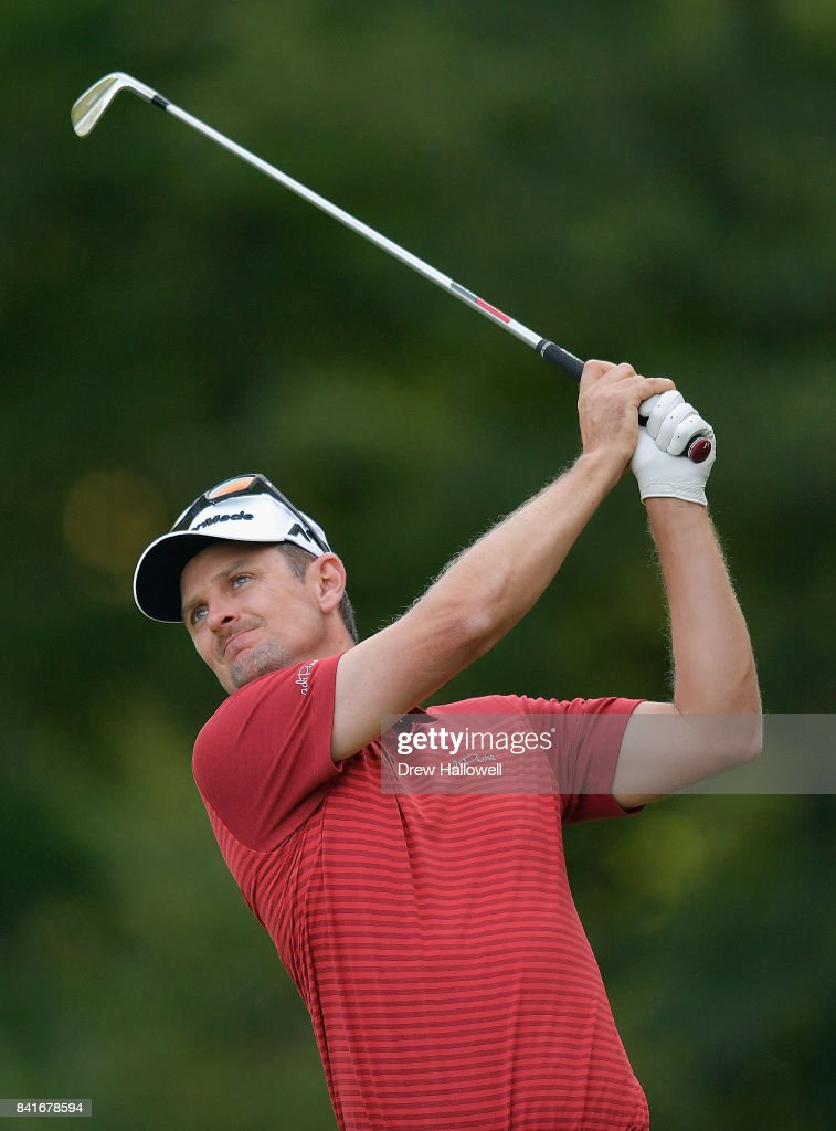 Justin Rose of England plays a shot on the eighth hole during round one of the Dell Technologies Championship at TPC Boston on September 1, 2017 in Norton, Massachusetts.