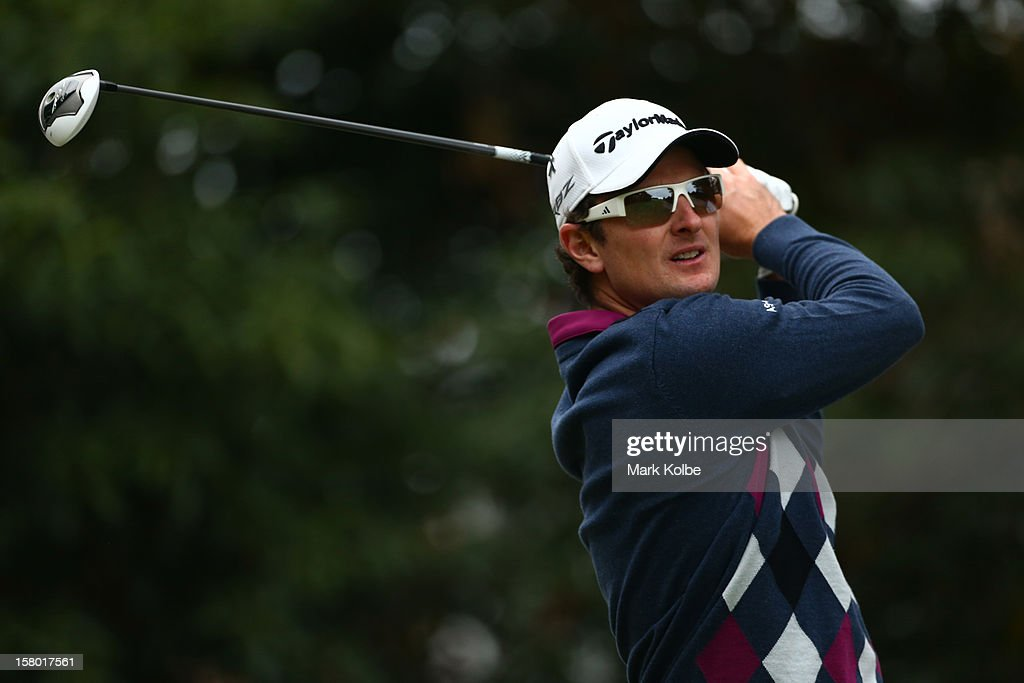 Justin Rose of England plays a tee shot during round four of the 2012 Australian Open at The Lakes Golf Club on December 9, 2012 in Sydney, Australia.