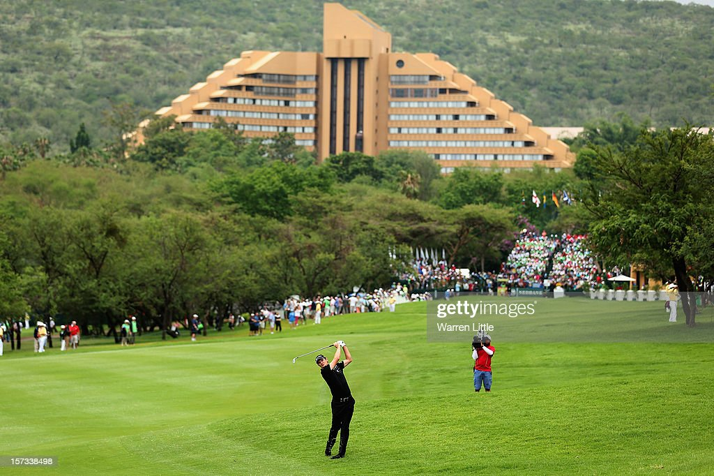 Justin Rose of England plays his second shot into the first green during the final round of the Nedbank Golf Challenge at the Gary Player Country Club on December 2, 2012 in Sun City, South Africa.