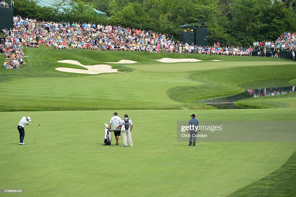 Justin Rose of England plays his second shot on the 14th hole during the final round of the Memorial Tournament presented by Nationwide at Muirfield...