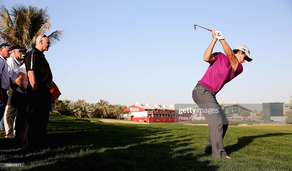 <a gi-track='captionPersonalityLinkClicked' href=/galleries/search?phrase=Justin+Rose&family=editorial&specificpeople=171559 ng-click='$event.stopPropagation()'>Justin Rose</a> of England plays his second shot on the 18th hole during the first round of the Abu Dhabi HSBC Golf Championship at the Abu Dhabi Golf Club on January 17, 2013 in Abu Dhabi, United Arab Emirates.