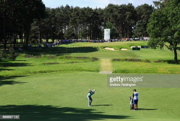 Justin Rose of England plays his second shot on the 7th hole during day three of the BMW PGA Championship at Wentworth on May 27 2017 in Virginia...