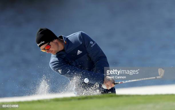 Justin Rose of England plays his second shot on the par 3 17th hole during the first round of the 2017 Arnold Palmer Invitational presented by...