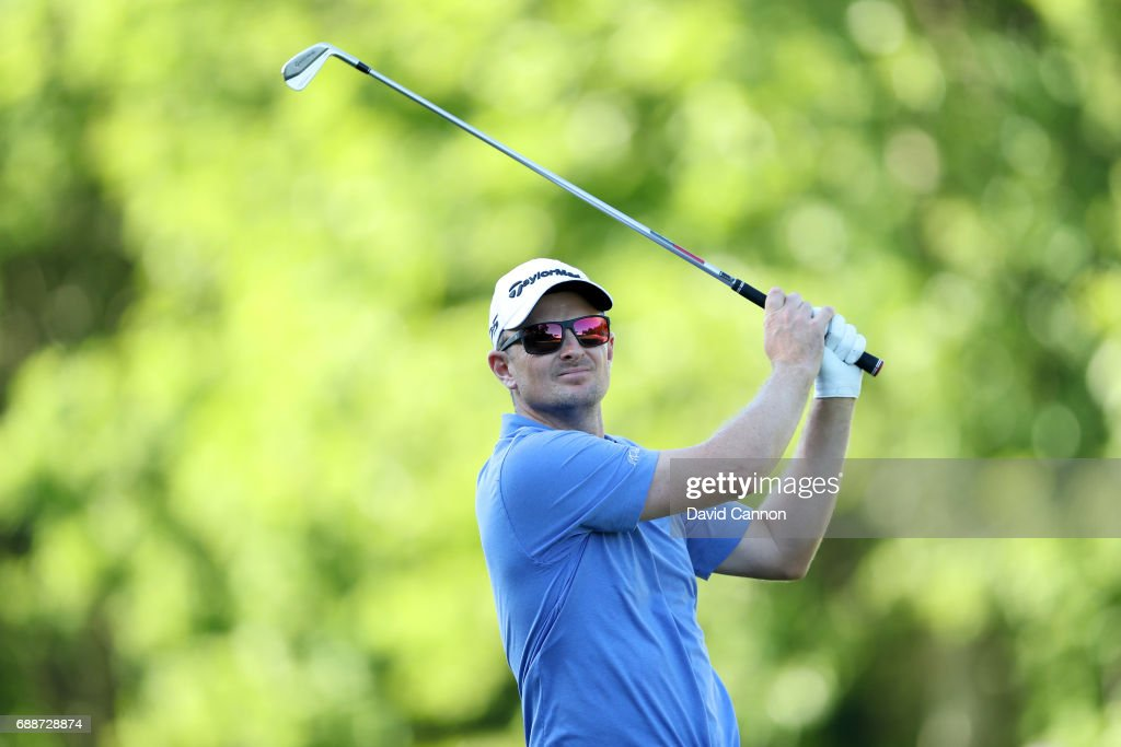 Justin Rose of England plays his second shot on the par 5, 18th hole during the second round of the 2017 BMW PGA Championship on the West Course at Wentworth on May 26, 2017 in Virginia Water, England.