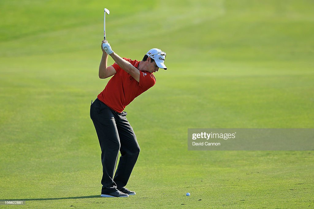 Justin Rose of England plays his second shot on the par five 14th hole during the first round of the 2012 DP World Tour Championship on the Earth Course at Jumeirah Golf Estates on November 22, 2012 in Dubai, United Arab Emirates.