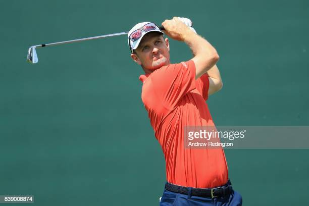 Justin Rose of England plays his shot from the 17th tee during round two of The Northern Trust at Glen Oaks Club on August 25 2017 in Westbury New...