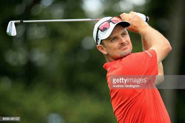 Justin Rose of England plays his shot from the second tee during round two of The Northern Trust at Glen Oaks Club on August 25 2017 in Westbury New...